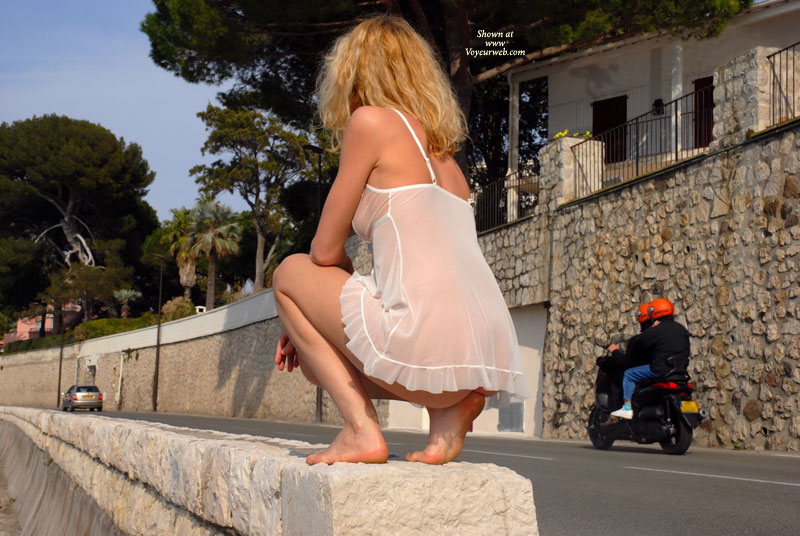 See-through In Public - Blonde Hair, Exhibitionist, Long Hair , Legs Bent, Negligee In Public, See Through Neglice, White See Thru Babydoll, White Negligee In Public, Squatting On Stone Wall, Blond In White Negligee Facing On-street Traffic, White Sheer Camisole, Sitting On Her Heel, See Through, White See Through Baby Doll