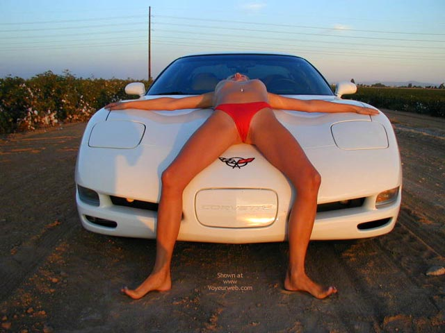On Her Back On A Car - Spread Legs , On Her Back On A Car, Legs Spread, Red Bikini Bottom