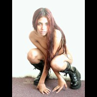 Wild Thing - Artistic Nude, Boots, Long Hair , Wild Thing, Punk Chick, Black Punker Boots, Long Red Hair, Artistic Shot, Lank Hair, Sleepy Expresion, Squating Arms Crossed Hand On Ground