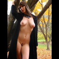Landing Strip - Brunette Hair, Landing Strip , Landing Strip, Very Buxum, Outdoors In A Park, Brunette, Flowing Brown Hair, Black Open Coat, Tilted Head