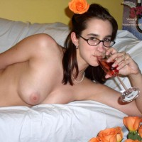Young Brunette In Bed - Glasses , Young Brunette In Bed, Flowers And Glasses, Drinking From Champagne Glass, Nerdy Glasses
