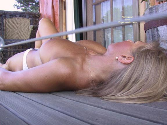 Brown Suntan , Brown Suntan, Topless Milf, Laying Down On Decking, Topless Blonde Laying Down From Overhead, Limbo Tits, Freckles On Breasts