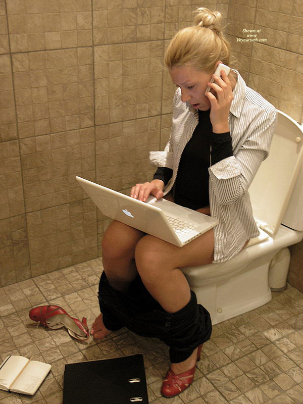 Using Laptop On Toilet , Red Business Pumps, Black Pants, Multitasking, Multitasking Woman On Toilet, Telecommuting Toilet Shot, Striped Button Down Shirt Black Undershirt, Macbook, Black And White Office Apparel, Ibook, Sitting On Toilet