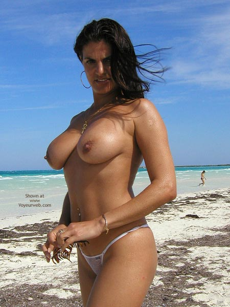 Topless Girl - Black Hair, Standing, Topless Girl, Beach Voyeur , Topless Girl, Beach Scene, Black Hair, Standing, White String Bikini, Hard Nipples, Navel Adornment