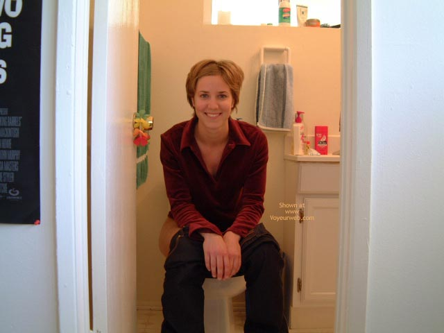 Sitting On Toilet - Jeans, Looking At The Camera , Sitting On Toilet, Pants Pulled Down, Smiling Into Camera, Short Brunette Hair, Looking At Camera, Blue Jeans, Red Blouse