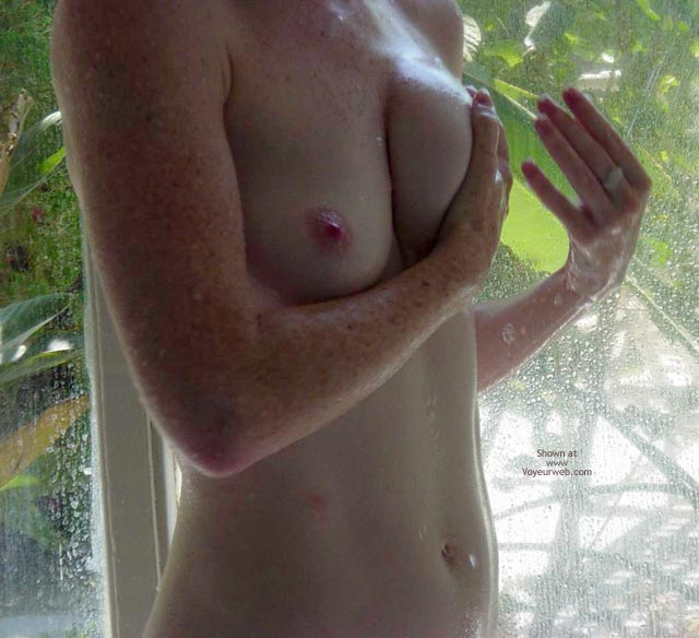 Freckled Arms , Freckled Arms, Closeup Of Wet Tits In Shower, Garden In Background, Wet Torso Naked In Shower