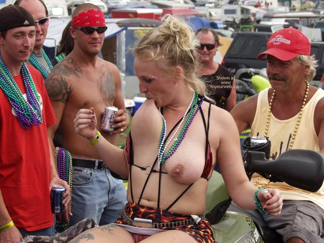 Pic #1 Biker Rodeo Chick Swallows Her Nipples!