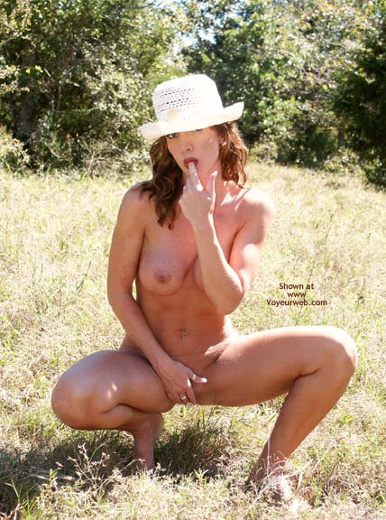 Fit In The Sunlight - Full Nude , Fit In The Sunlight, Nude Girl Outdoors, Wearing A Hat, Licking Her Finger, Sucking Her Finger, Finger In Mouth, Fully Naked, Frontal View