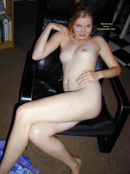 The Creamy Temptress - Legs Crossed, Small Breasts, Looking At The Camera , The Creamy Temptress, Red Head On Black Leather, Small Breasts, Looking Into Camera, Legs Crossed, Smiling At Camera, Reclining An A Chair