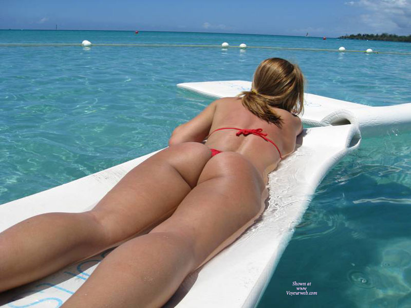 Beach Buns , View From Behind, Red Thong Cuttie, Sunbathing On Water, Ass In Thong, Beach, String Bikini Top And Thong, Red Bikini, Lying On Stomach, Sun Tan, Bikini, Floating In The Bay, Floating On A Board