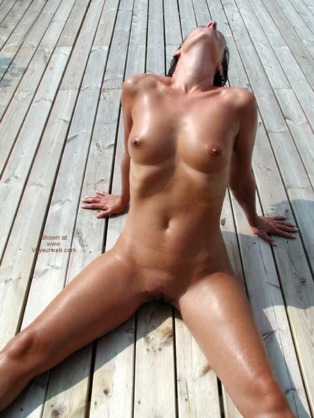 Pic #1 Kristin Sprawling in The Sun