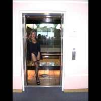 The Beautiful Woman in a Glass Elevator