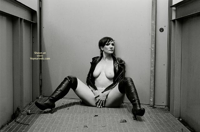 Sunbathing In Industrial Complex , Sunbathing In Industrial Complex, Sitting Nude, B And W Legs Spread Pussy Covered, Fetish Shot, Long Black Boots, Black Leather
