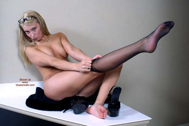 Girl Dressing Her Stockings - Blonde Hair, Glasses, Heels, Stockings , Girl Dressing Her Stockings, Heels, Blonde, Black Stockings, Stretched Leg, Glasses