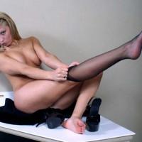 Girl Dressing Her Stockings - Blonde Hair, Glasses, Heels, Stockings , Girl Dressing Her Stockings, Heels, Blonde, Black Stockings, Stretched Leg, Glasses