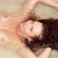 Mermaid Splash , Mermaid Splash, Nude In Tub With Henna Hair, Topless With Arms Above Head, Floating Hair