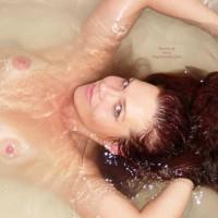 Mermaid Splash , Mermaid Splash, Nude In Tub With Henna Hair, Topless With Arms Above Head, Floating Hair
