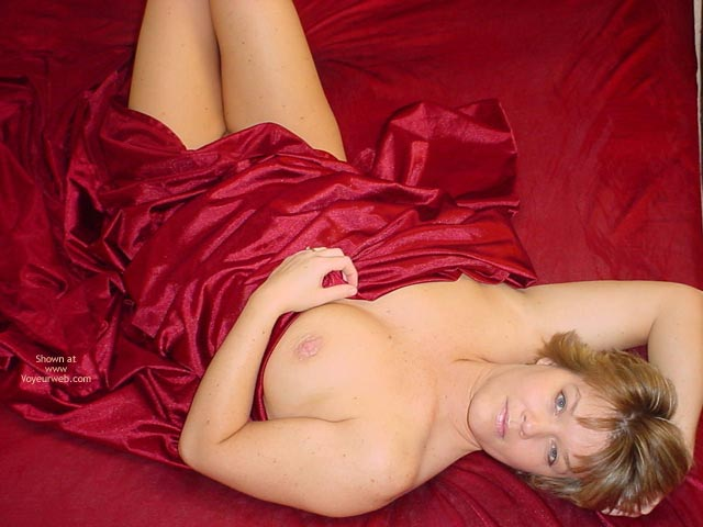 Laying Back On Satin Sheets - Looking At The Camera , Laying Back On Satin Sheets, Short Hair Blonde, Looking Into Camera Smiling