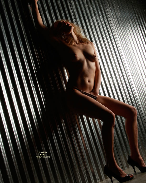 Nude Girl Shadow Light - Blonde Hair, Heels, Naked Girl, Nude Amateur , Erotic Photo, Hand In Panties, Dark Shadows, Open Toed Shoes, Against The Wall, Naked On Metal Wall, Nude Girl Standing Against Wall
