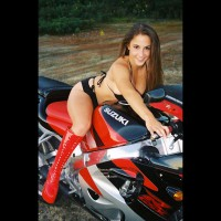 On Motorcycle - Long Hair, Looking At The Camera , On Motorcycle, Long Brown Hair, Red Boots, Wearing Black Bikini, Smiling Into Camera