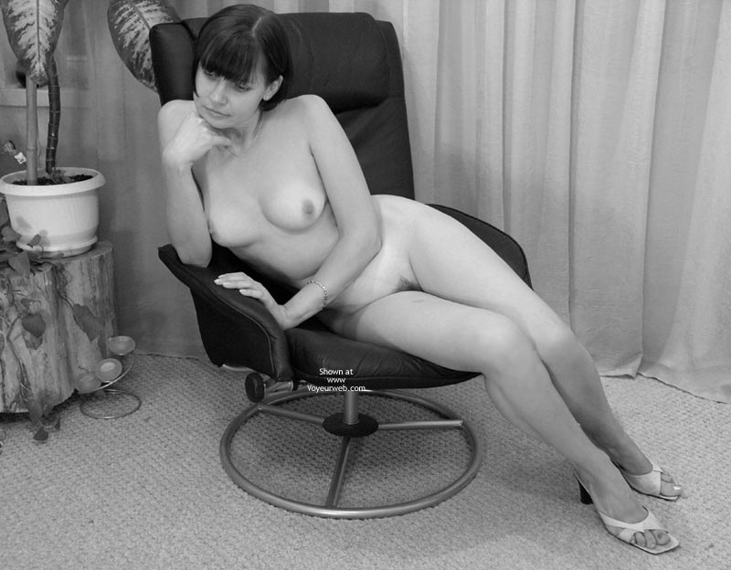 Black  White - Milf , Black  White, Classic Milf, White Heels, Elbows On Arm Of Office Chair, Neatly Trimmed Landing Strip