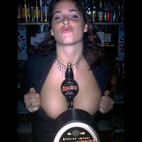 A Very Busty Barmaid Flashing At Work