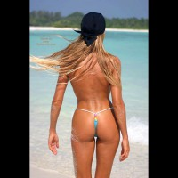Bronzed Body - On Beach, Rear View, Sexy Body , Bronzed Body, Just A G-string, Walking On Beach, Butt Floss, Ass On Beach, Sand On Tanned Skin, Rear View, Blonde Hair Flowing In Wind