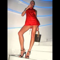 Pantieless Party Girl - Long Legs , Red Micro Dress, Upskirt, Pantyless, Stilleto Heels, Sexy Pose On Winding Stairs, Classic Little Red Dress, Girl With Longs Legs On Stairs, Red Miniskirt, No Panties Under Dress, Louis Vuitton Handbag, Red Dress