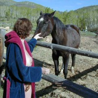 Marie Topless And Feeding A Horse