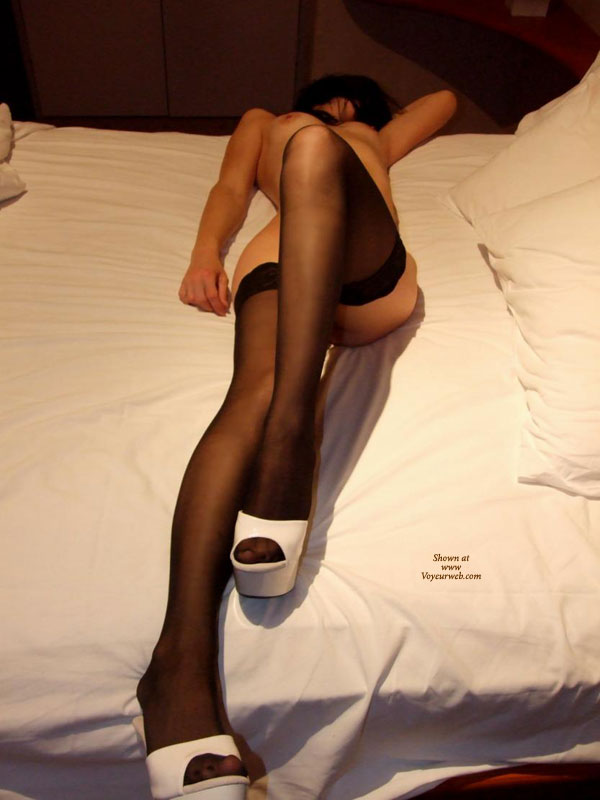 Naked On The Bed In Black Stockings And White Platform Shoes - Erect Nipples, Long Legs, Stockings , Naked On Bed With White Sheets, Face Hidden, Leg Bent With Knee Up, Lean Atheletic Body, Slim And Naked, Black Silk Stockings, Long Shapely Legs, Hand Behind Head