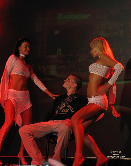 Pic #1 Two strippers teasing one guy