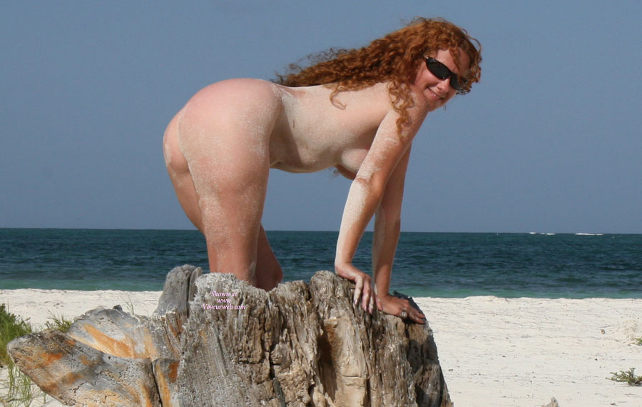 Nudist Redhead On A Beach. - Sunglasses, Naked Girl, Nude Amateur , Redhead At A Sandy Beach, Sunglasses And Smile, Redhead With Fantastic Ass Nude At The Beach., Sand Covered Readhead At The Beach., Natural Bodied Sexy Woman, Body Covered In Sand, Nude Leaning On Rocks On Beach, Long Red Curls, Dark Glasses And A Smile