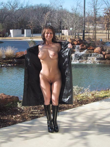 Long Coat Flash - Boots , Long Coat Flash, Outdoor In The Park, High Heeled Boots, Black Boots, Nature Flashing, Flashing In Front Of Pond, Flashing With Black Coat, Flashing In Front Of Waterfall