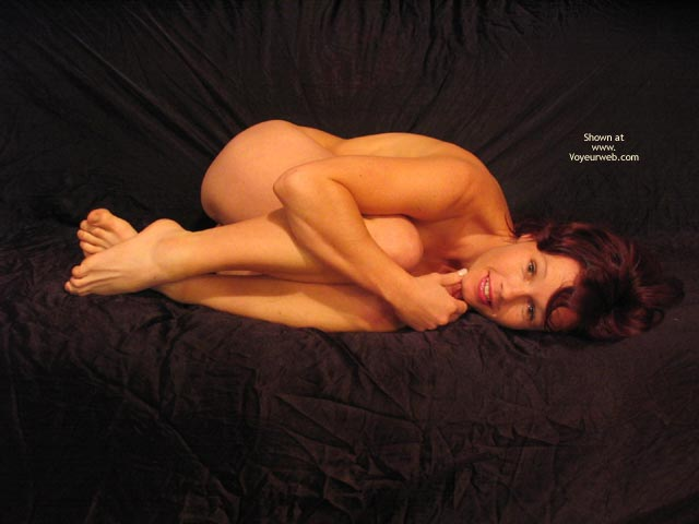 Girl Laying Naked On A Bed - Leg Up , Girl Laying Naked On A Bed, Pulling Her Legs Up, Covering Breast Behind Her Legs
