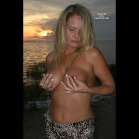 On Beach At Sunset , On Beach At Sunset, Pinching Nipples, Sunset Nipple Squeeze, Blonde Topless