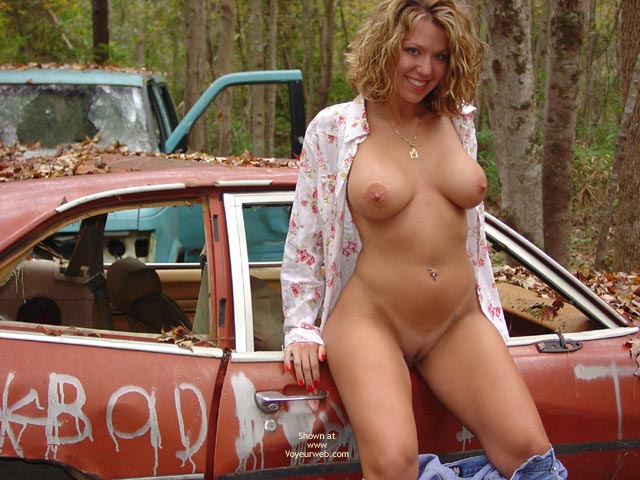 Devilish Grin - In The Woods , Devilish Grin, Stripping Outside, Standing By Automobiles, In The Woods, Nude In Car Junk Yard, Shaved Blonde
