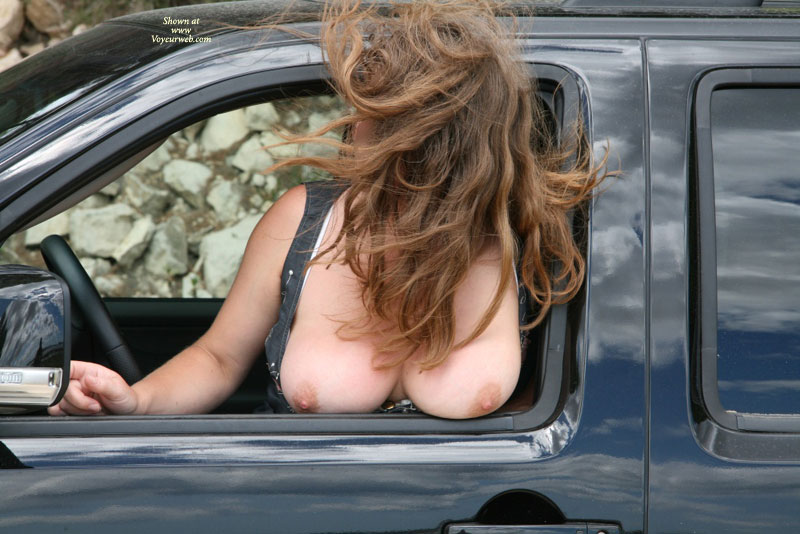 Boob flashing through window