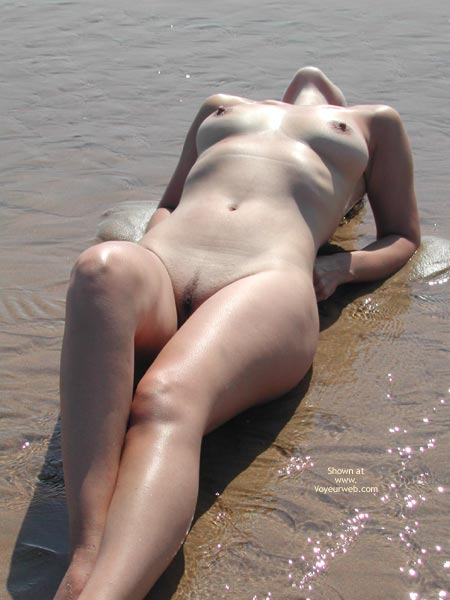 Lying Naked On Beach In The Water - Landing Strip , Lying Naked On Beach In The Water, Medium Sized Tits, Landing Strip, Arched Back, Fully Nude
