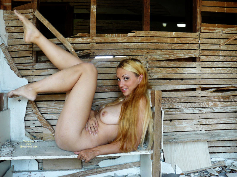 Hottie On Rubble - Blonde Hair, Large Breasts, Long Hair, Long Legs, Looking At The Camera, Naked Girl, Nude Amateur , Sexy Babe, Nude Outside, Reclined With Legs Up, Arched Eyebrows, Wicked Smile, Legs Up, Very Long Strawberry Blond Hair., Posing Outdoors