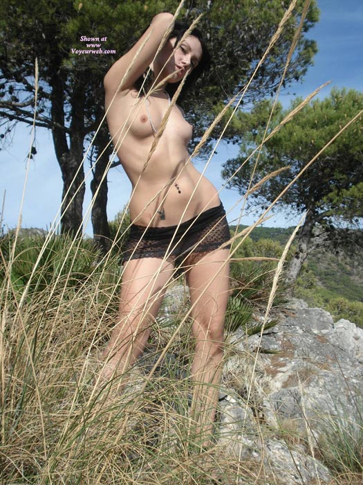 Topless Girl Standing Outdoors - Dark Hair, Navel Piercing, Topless , Topless Girl Stands Amid The Rushes, Topless Girl On Rock, Small Titties, Small Playboy Tattoo, Topless Girl Posing In Grass, Wilderness Naked, Topless Pose Outdoors