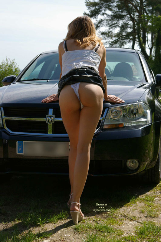Great Ass In Short Skirt And White Lace Panties - Blonde Hair, Heels, Long Hair, Long Legs , White Lace Panties, White Spaghetti Strap Top, Skirt Hiked Up, Rear View, Bent Over The Hood Of A Ram, Public Upskirt, White G-string