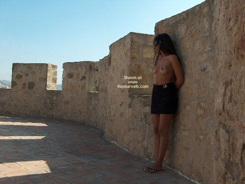 Against A Wall - Nude Outdoors, Topless In Public , Against A Wall, Outdoors, Naked Breasts In Public, Topless In Public, Posing By Wall, Flip Flop Sandals, Black Skirt