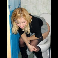 Girl Pissing On Toilet - Blonde Hair, Stockings , Toilet Shot, Black Studded Boots, Black Pantyhose And Black Calh Heighr Boos With Studs, Black Top/boots/stockings, No Privacy, Black Short Sleeved Top