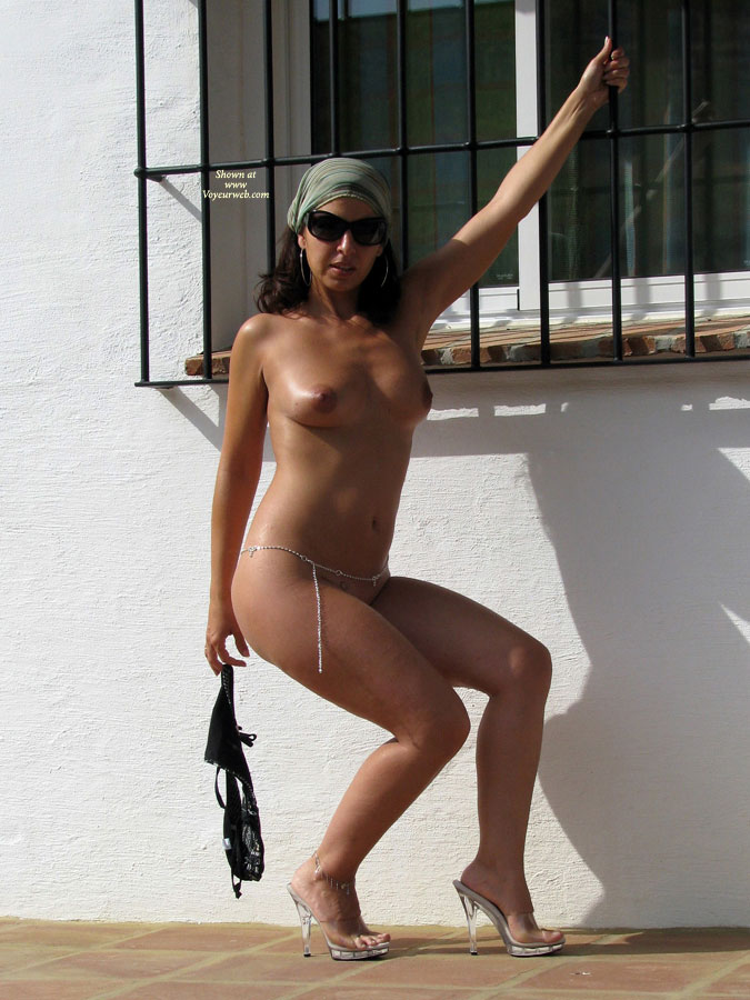 Nude With Sunglasses - Brunette Hair, Heels, Nude Outdoors, Sunglasses, Naked Girl, Nude Amateur , Naked Outside, Tanned All Over, Silver Waist Chain, Big Sunglasses, Standing In High Heels, Brunette Nude, Black Sunglasses, Posing In Front Of White Wall, Dark Nipples