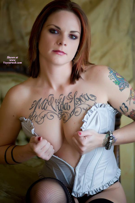 Sexy Tattooed Girl - Big Tits, Small Tits , Corset And Fishnet Stockings, Body Art, White Satin Corset, Corsets To Small, Standing, Cupping Tits With Corset, Fishnet Hose, Sitting Holding Bustier Closed, Big Titties, Tatooed, Tattoo, Beautiful Eyes