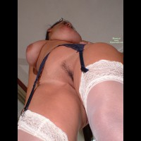 Feathered Landingstrip - Dark Hair, Landing Strip , Shot From Below, Large, Pendulous Tits, Pussy And Breasts, From Below, Dramatic Upwards Shot, Blue Garters And White Stockings, White Thigh Highs Lace Tops, Thighs, Belly And Breasts Exposed