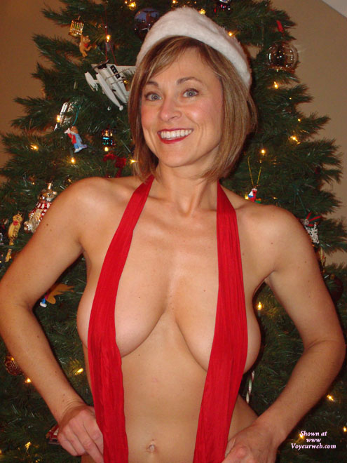 X-mas Boobs - Big Tits, Large Breasts , Big Smile, Bright Eyes, Covered Tits, Winning Smile, Naughty Elf, Shapely Tits, Santa's Helper, Standing In Front Of Christmas Tree, Secret Santa Gift