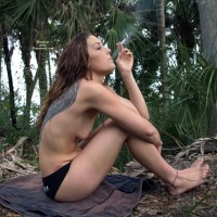 Tatooed Topless Girl Smoking - Long Hair, Topless , Smoking On The Beach, Sitting With Toes Up, Sitting On Ground, Outside Topless Smoking, Small Titties, Rugged Feet, Tatooed Girl Smoking In The Woods, Sitting On The Ground