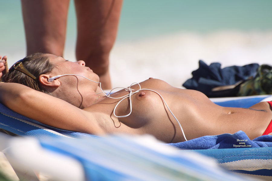Unaware Sunbather - Firm Tits, Topless Beach, Topless, Beach Tits, Beach Voyeur , Lying Down On Beach Chair, Pink Nipples, Sunbathing Small Boobs, Sunbathing With Ipod, Topless On A Beach Listening To Music, Shaved Armpits, Firm Breast, Voyeur Tits