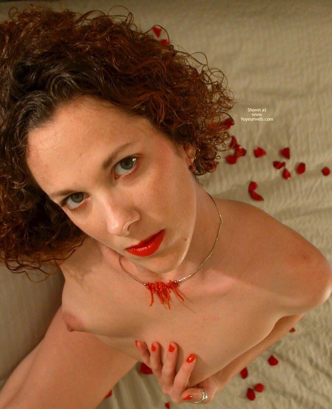 Posed Indoors - Eye Contact, Green Eyes, Pale Skin , Posed Indoors, Lipstick, Rose Petals, Red Lips And Nails, Eye Contact, Curly Auburn Hair, Green Eyes, Pale Skin